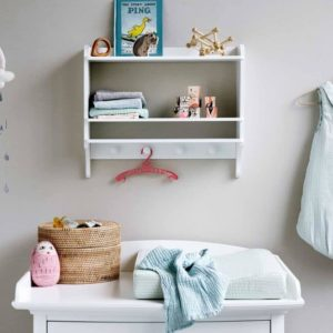 Nursery featuring organic cotton muslin cloth in petroleum blue