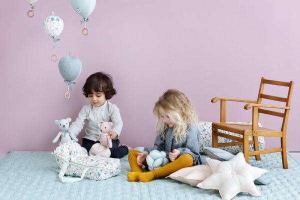 Little ones playing in playroom with Cam Cam star shaped cushions