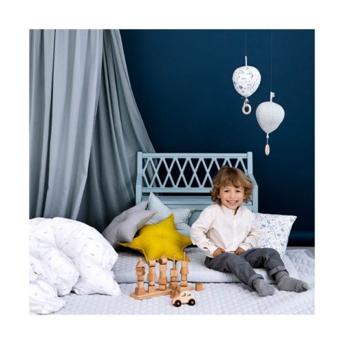 Kids room featuring bed canopy in dot blue mist