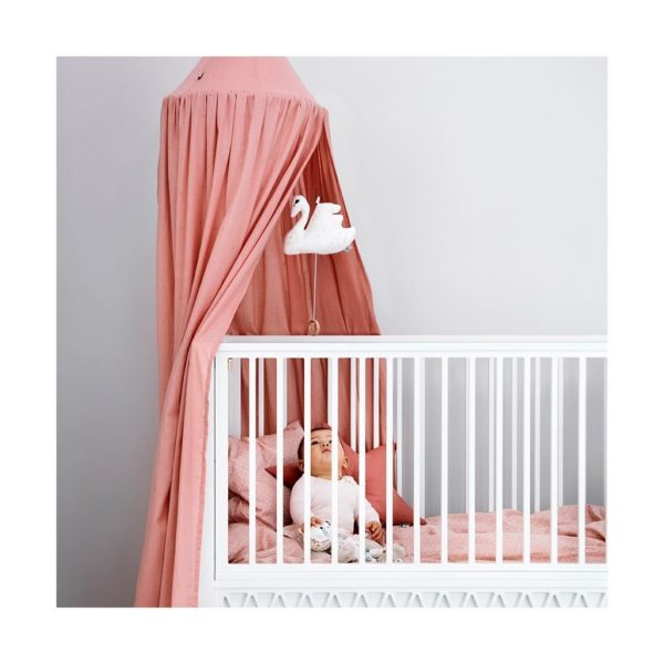 Nursery cot with bed canopy in dot old rose
