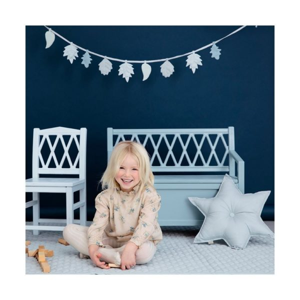 Child playing in room featuring leaves garland in mix blue