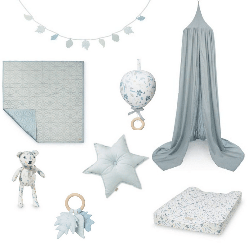 Blue mist nursery design with blue cot canopy sustainable toys star cushion baby quilt and changing mat