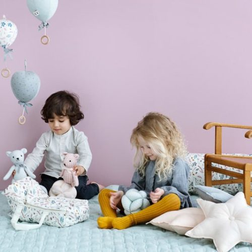 Children playing with dolls lift pressed leaves rose in nursery