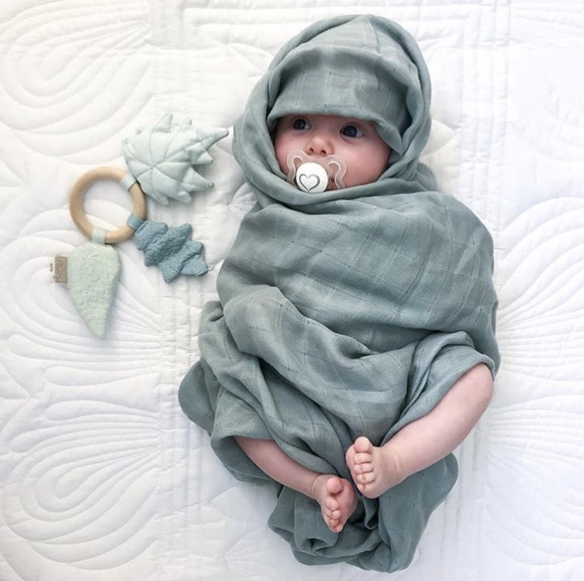 Baby in organic baby muslin wrap