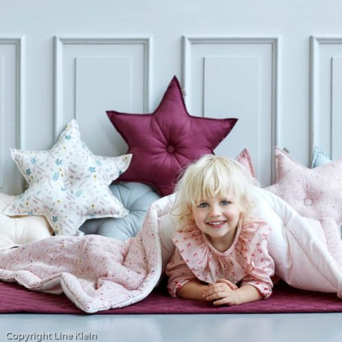 Cam Cam star shaped decorative cushions in nursery