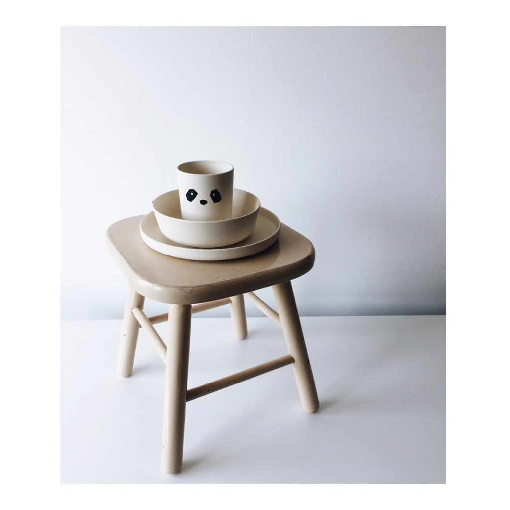 Bamboo plate set for kids on a stool