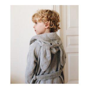 A boy with a rabbit ear bath robe