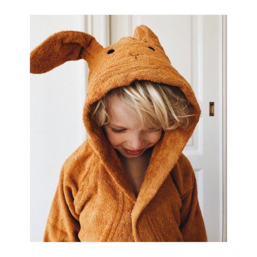 Boy with a mustard rabbit bath robe
