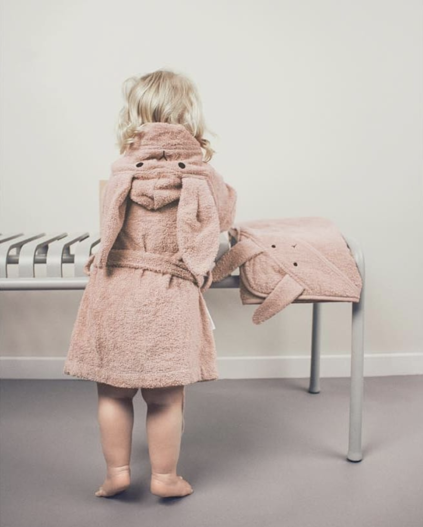 Child wearing rabbit rose bathrobe with matching hooded towel