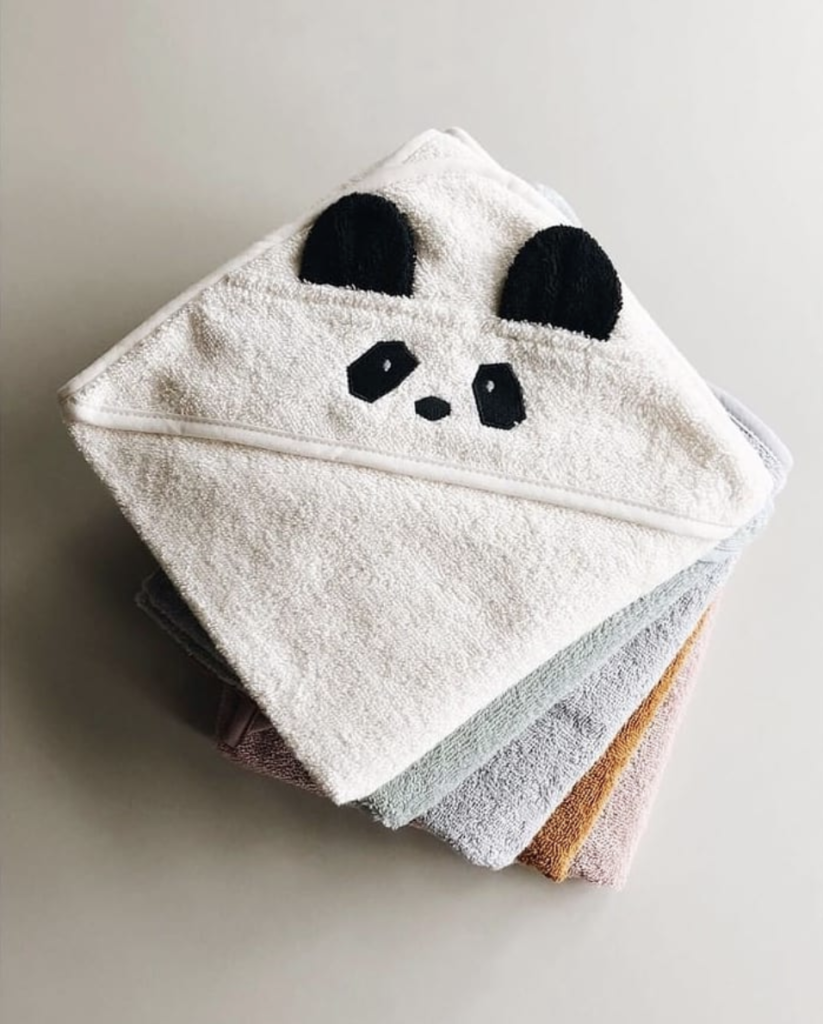 Stack of hooded baby towels by Liewood