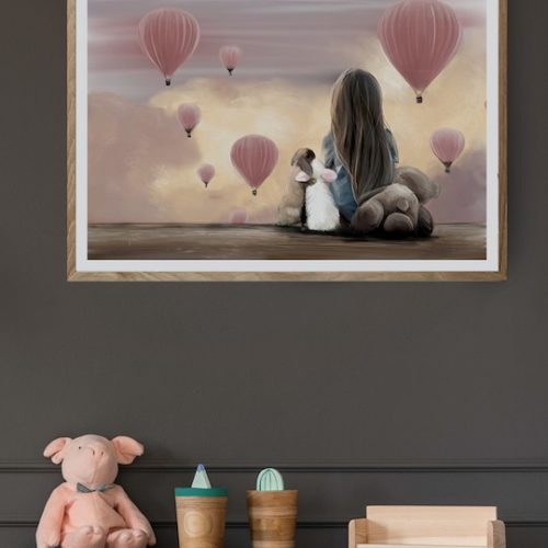 nursery wall art of girl sitting with rabbits watching pink hot air balloons at sunset