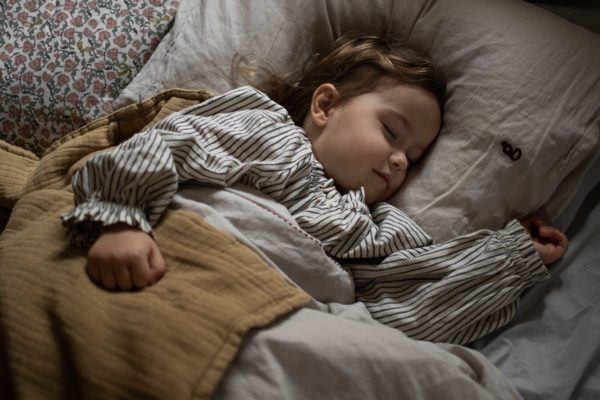 Sleeping kid with soft cotton straw swaddle blanket