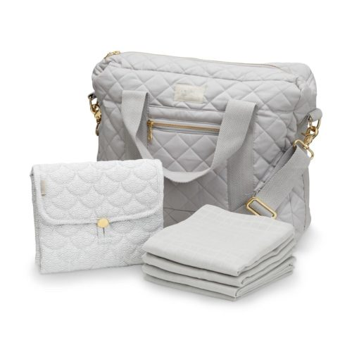 Grey nappy bag with soft grey wave travel change mat with soft grey organic muslins in front of them