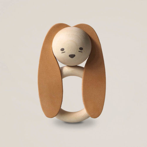 Cute baby leather and natural wooden teether in a shape of a bunny with long ears